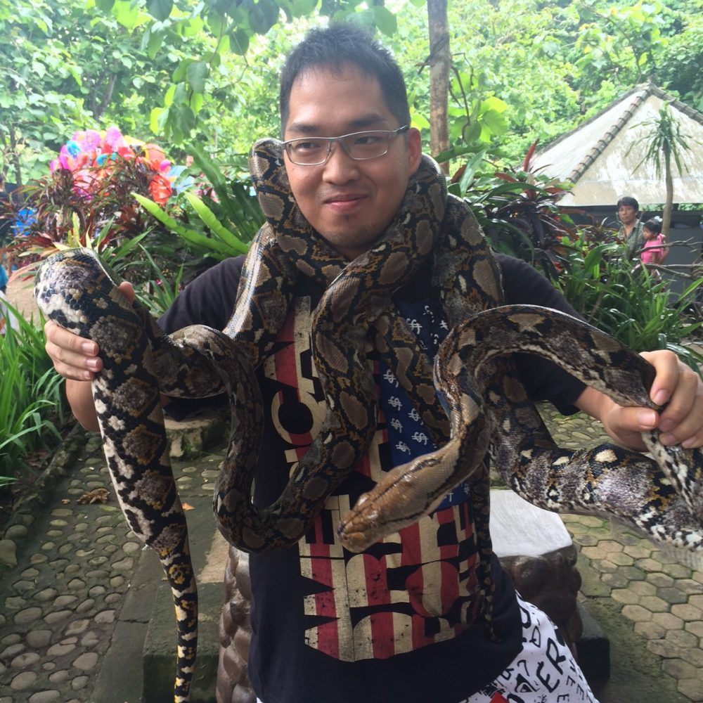 Photo with snake at Alas Kedaton in Bali