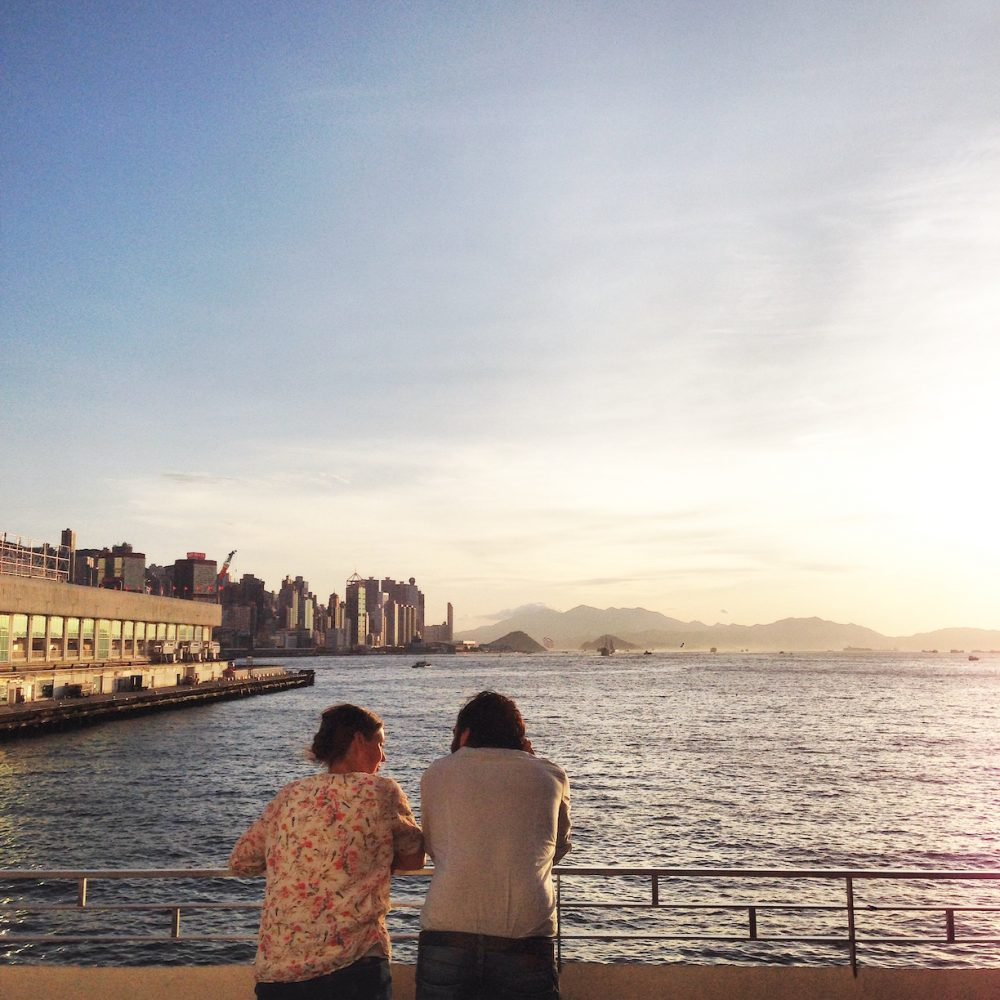 Couple enjoying sunset at Harbour City Hong Kong