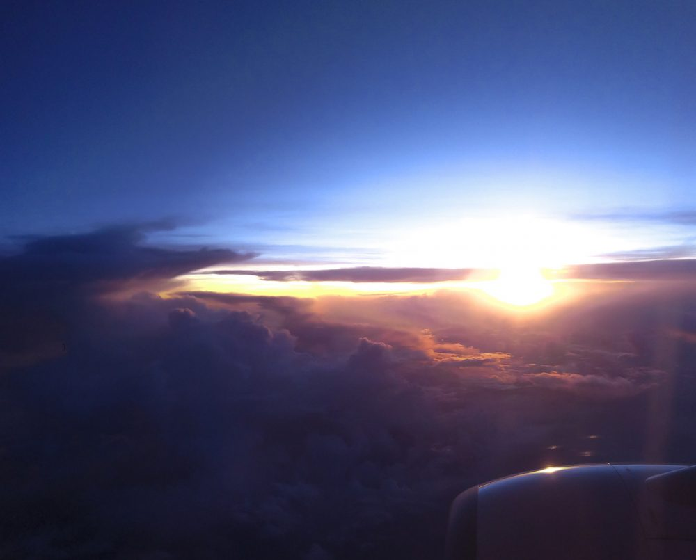 Sunset view from inside the plane to KL