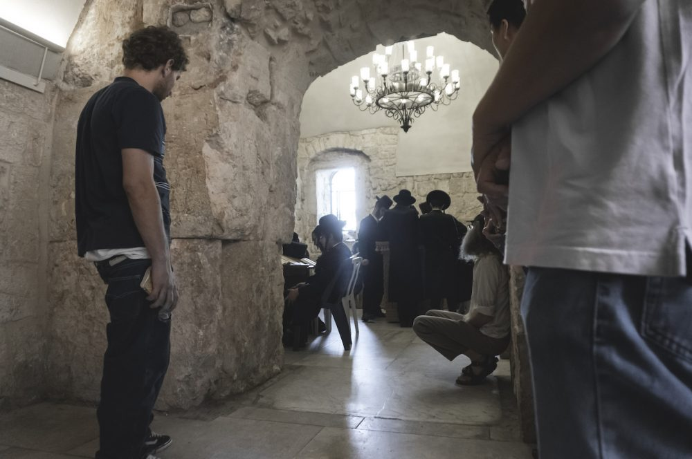 Orthodox Jews praying in the King David Tomb Jerusalem