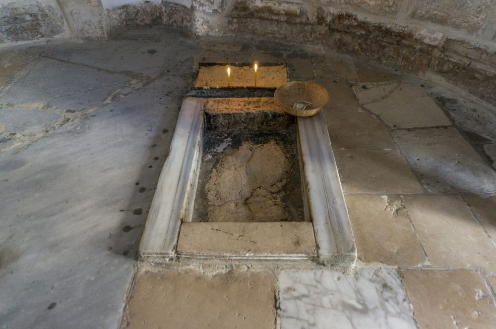 Jesus Footprint inside The Chapel of Ascension Jerusalem