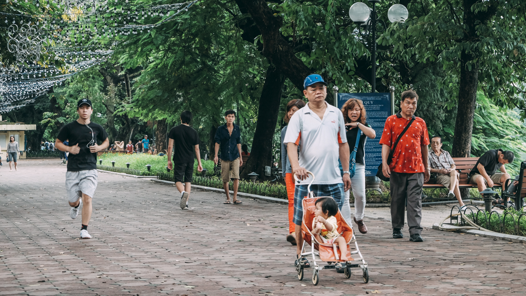 People doing afternoon walk around Hoan Kiem Lake
